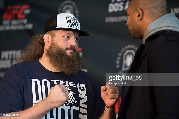 Roy Nelson faces off with Alistair Overeem during the UFC 185 Ultimate Media Day at the American Airlines Center on March 12 2015 in Dallas Texas