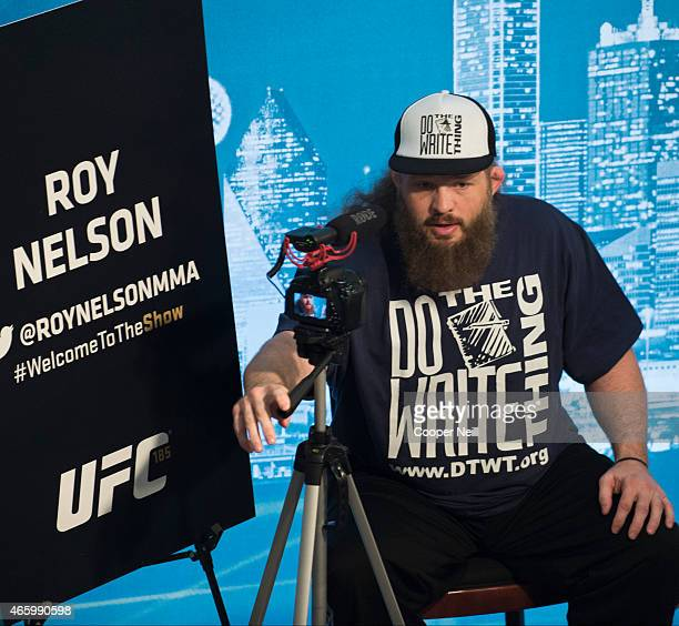 Roy Nelson films himself during the UFC 185 Ultimate Media Day at the American Airlines Center on March 12 2015 in Dallas Texas