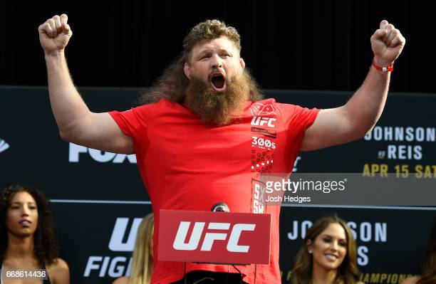 Roy Nelson poses on the scale during the UFC Fight Night weighin at the Kansas City Power Light District on April 14 2017 in Kansas City Missouri