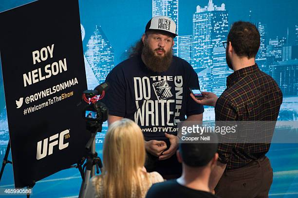 Roy Nelson speaks with the media during the UFC 185 Ultimate Media Day at the American Airlines Center on March 12 2015 in Dallas Texas