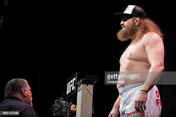 Roy Nelson stands on the scale during the UFC 185 weighins at the Kay Bailey Hutchison Convention Center on March 13 2015 in Dallas Texas