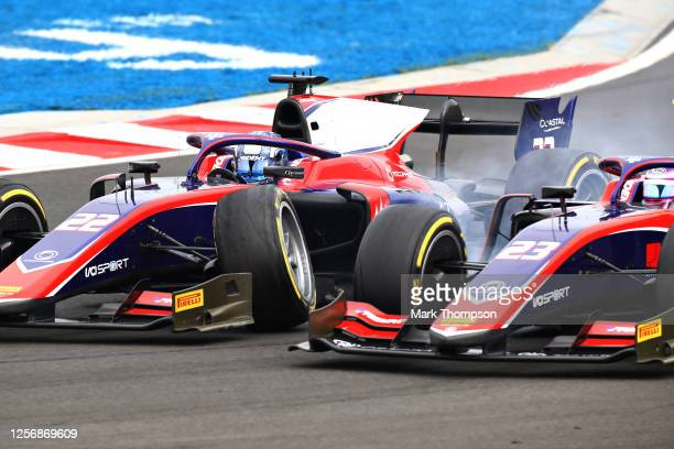 Roy Nissany of Israel and Trident and Marino Sato of Japan and Trident crash during the feature race for the Formula 2 Championship at Hungaroring on...