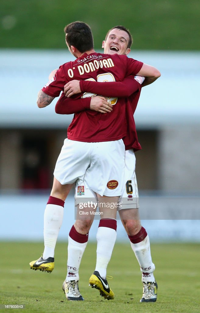 Roy O'Donovan of Northampton Town celebrates with team mate Lee Collins after scoring during the npower League Two Play Off Semi Final First Leg match between Northampton Town and Cheltenham Town at Sixfields on May 2, 2013 in Northampton, England.