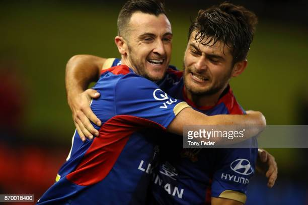 Roy O'Donovan of the Jets celebrates a goal with teammate Ivan Vujica during the round five ALeague match between the Newcastle Jets and the...