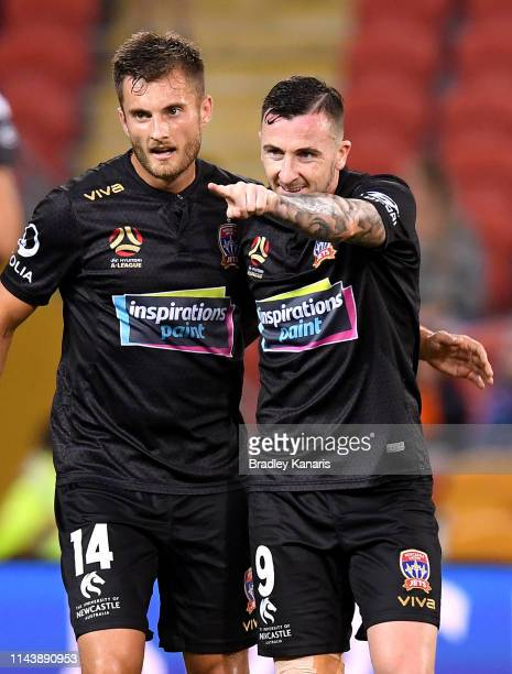 Roy O'Donovan of the Jets celebrates scoring a goal during the round 26 ALeague match between the Brisbane Roar and the Newcastle Jets at Suncorp...