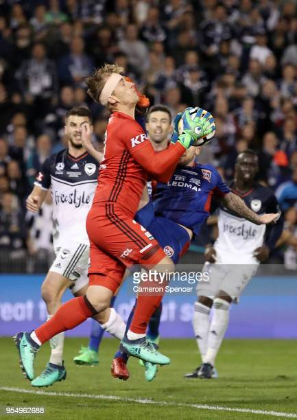 Roy O'Donovan of the Jets collides with Lawrence Thomas of the Victory during the 2018 ALeague Grand Final match between the Newcastle Jets and the...