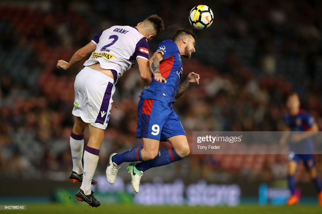 Roy O'Donovan of the Jets contests a header with Alexander Grant of the Glory during the round 26 A-League match between the Newcastle Jets and the Perth Glory at McDonald Jones Stadium on April 6, 2018 in Newcastle, Australia.