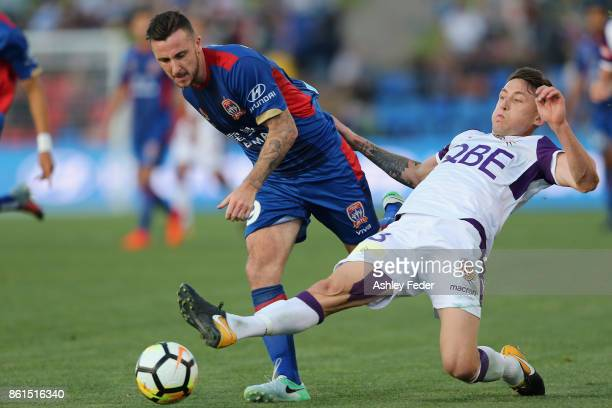 Roy O'Donovan of the Jets contests the ball against Scott Neville of Perth Glory during the round two ALeague match between the Newcastle Jets and...
