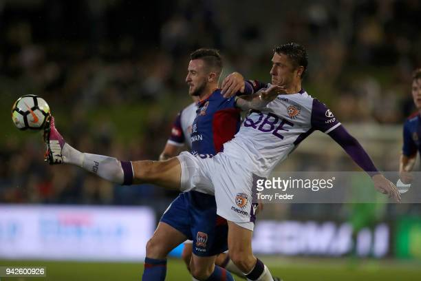 Roy O'Donovan of the Jets contests the ball with Dino Djulbic of the Glory during the round 26 ALeague match between the Newcastle Jets and the Perth...