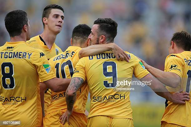 Roy O'Donovan of the Mariners celebrates a goal with team mates during the round one ALeague match between the Central Coast Mariners and the Perth...