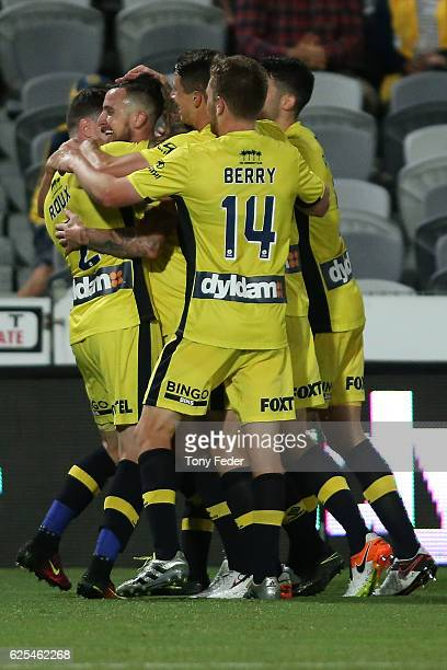 Roy O'Donovan of the Mariners celebrates a goal with team mates during the round eight ALeague match between the Central Coast Mariners and the Perth...