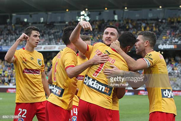 Roy O'Donovan of the Mariners celebrates his goal with team mates during the round 11 ALeague match between the Central Coast Mariners and Brisbane...