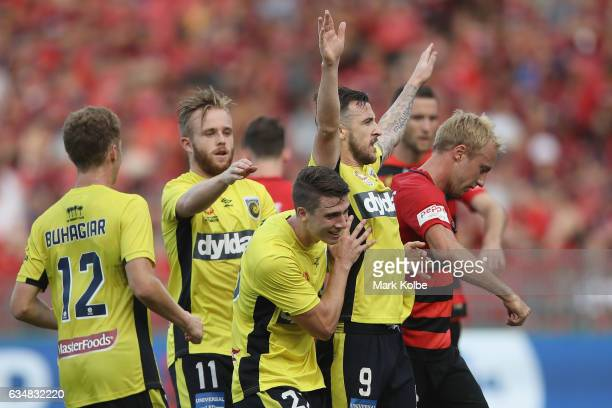 Roy O'Donovan of the Mariners celebrates with his team mates after scoring a goal during the round 19 ALeague match between the Western Sydney...