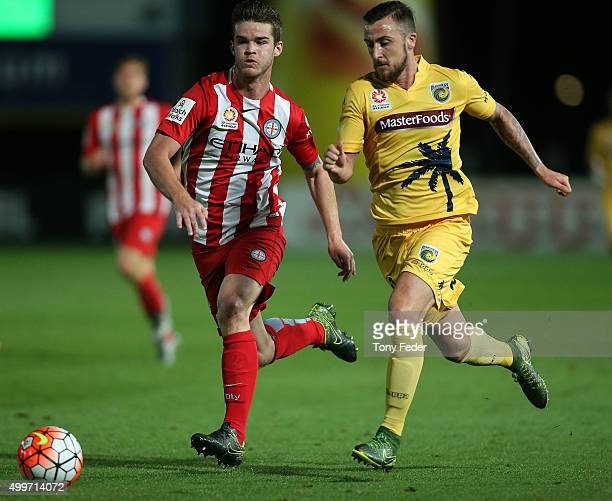 Roy O'Donovan of the Mariners contests the ball with his Melbourne City opponent during the round nine ALeague match between the Central Coast...