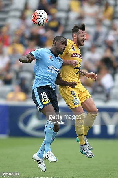 Roy O'Donovan of the Mariners contests the ball with Jacques Faty of Sydney FC during the round four ALeague match between the Central Coast Mariners...
