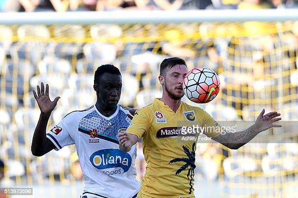 Roy O'Donovan of the Mariners contests the header against Thomas Deng of the Victory during the round 22 ALeague match between the Central Coast...