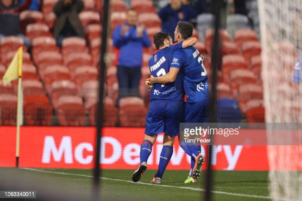 Roy O'Donovan of the Newcastle Jets celebrates a goal with team mates during the round 29 ALeague match between the Newcastle Jets and Western United...