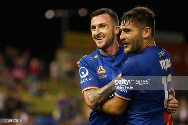 Roy O'Donovan of the Newcastle Jets celebrates his goal with team mates during the round 19 ALeague match between the Newcastle Jets and Melbourne...