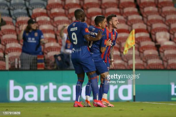 Roy O'Donovan of the Newcastle Jets celebrates his goal with team mates Dimitri Petratos and Abdiel Arroyo during the round 20 ALeague match between...
