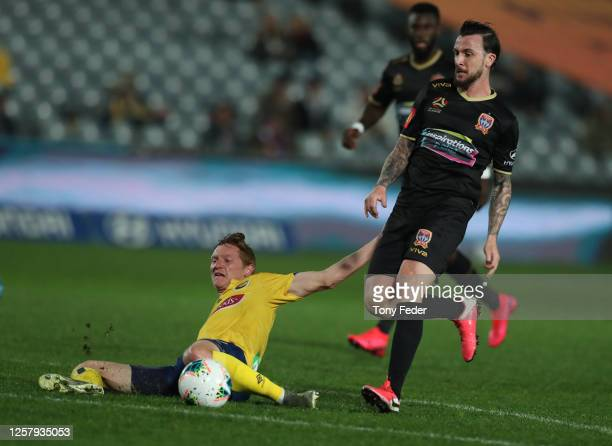 Roy O'Donovan of the Newcastle Jets contests the ball with Kye Rowles of the Central Coast Mariners during the round 25 A-League match between the...