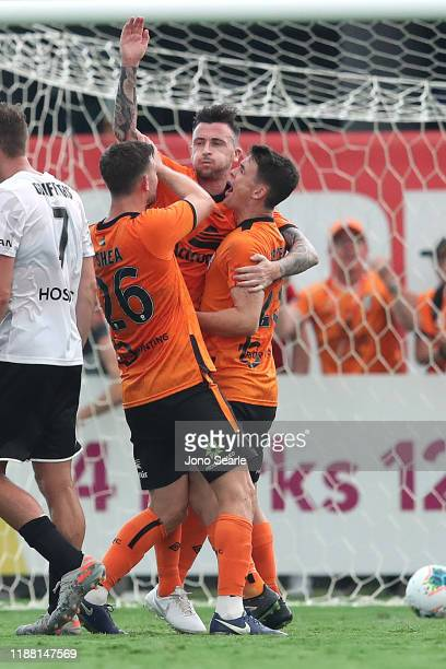 Roy O'Donovan of the Roar celebrates a goal with team mates during the round six ALeague match between Brisbane Roar and Melbourne City at Dolphin...