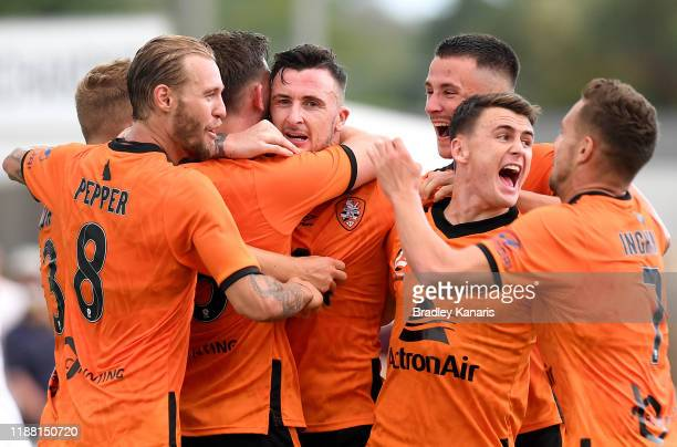 Roy O'Donovan of the Roar is congratulated by team mates after scoring a goal during the round six ALeague match between Brisbane Roar and Melbourne...