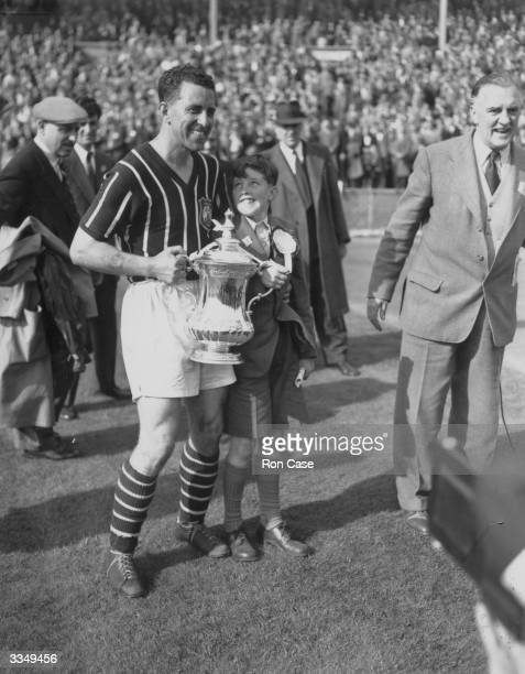 Roy Paul captain of Manchester City clutches the FA Cup trophy after his side's 31 victory over Birmingham City in the FA Cup final at Wembley...
