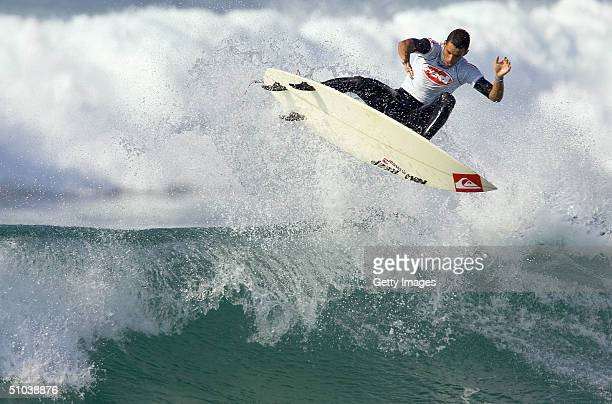 Roy Powers of Hawaii wins won his heat to advance to the round of 64 surfers at the Mr Price Pro surfing compitition July 8, 2004 in North Beach,...