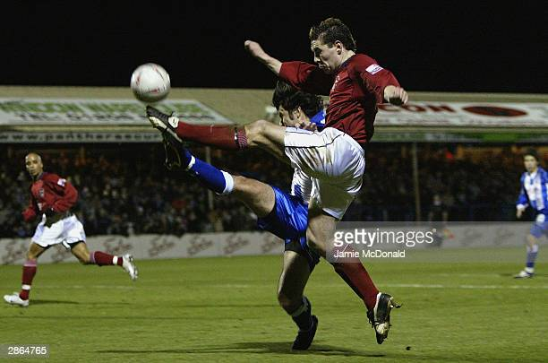 Roy Prendergast of Accrington clashes with Kem Izzet of Colchester during the FA Cup third round replay match between Colchester United and...