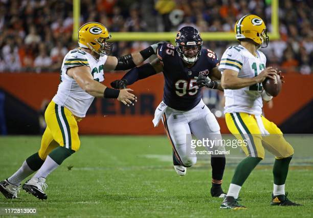 Roy Robertson-Harris of the Chicago Bears rushes past Corey Linsley of the Green Bay Packers towards Aaron Rodgers at Soldier Field on September 05,...