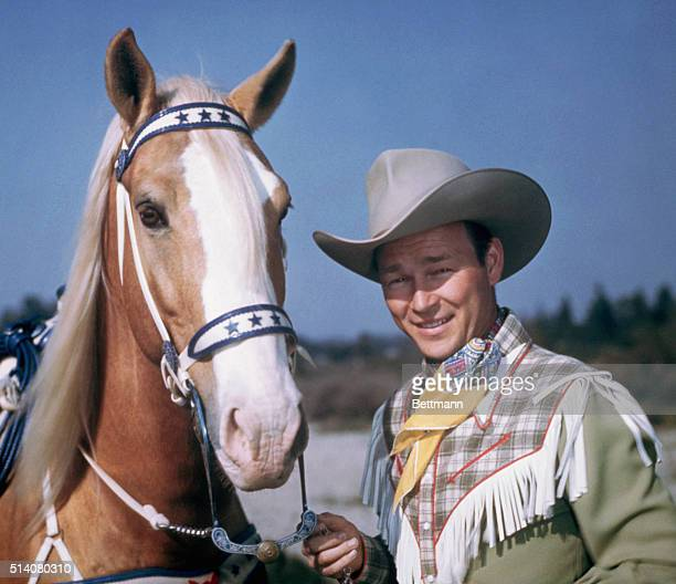 Roy Rogers an American actor and singer and his horse Trigger