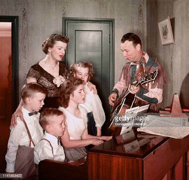 Roy Rogers and Dale Evans with their family at home in 1958'