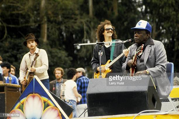 Roy Rogers, Carlos Santana and John Lee Hooker performing in Golden Gate park in San Francisco, California on June 23, 1985.