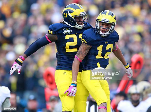 Roy Roundtree of the Michigan Wolverines celebrates a second quarter catch with Junior Hemingway while playing the Purdue Boilermakers at Michigan...