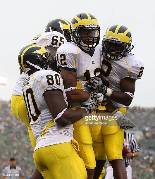 Roy Roundtree of the Michigan Wolverines celebrates a touchdown with teammates Martell Webb, Patrick Omameh and Vincent Smith against the Notre Dame...