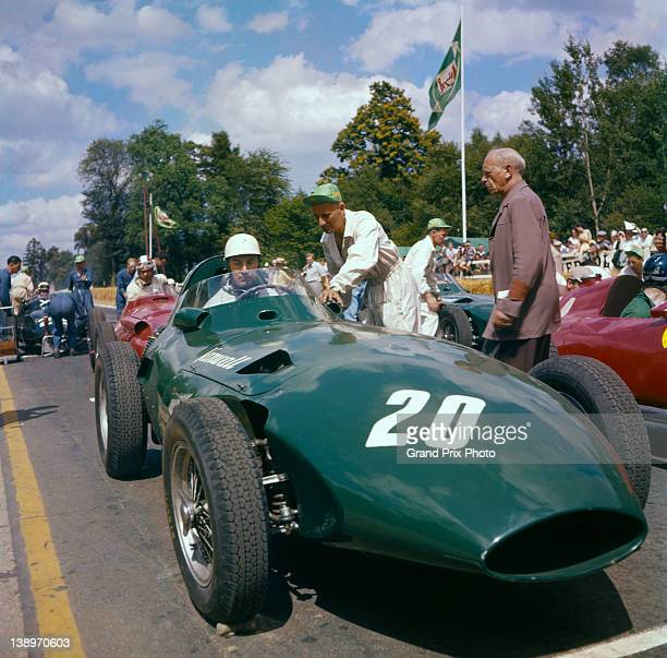 Roy Salvadori of Great Britain sits aboard the Vandervell Products Ltd Vanwall I4 on the grid before the start of the French Grand Prix on 7th July...