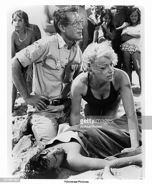 Roy Scheider and Lorraine Gary huddle anxiously over their son Chris Rebello in a scene from the film 'Jaws' 1975