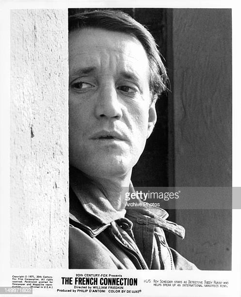 Roy Scheider standing behind wall in a scene from the film 'The French Connection' 1971