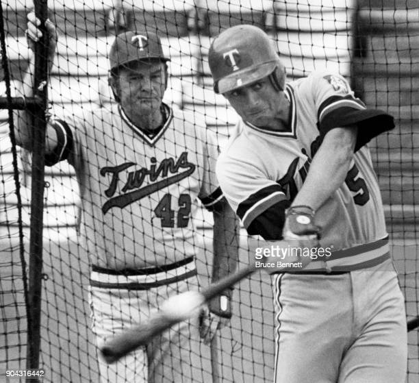 Roy Smalley of the Minnesota Twins takes batting practice as hitting coach Billy Gardner watches during Spring Training on March 2 1981 in Orlando...