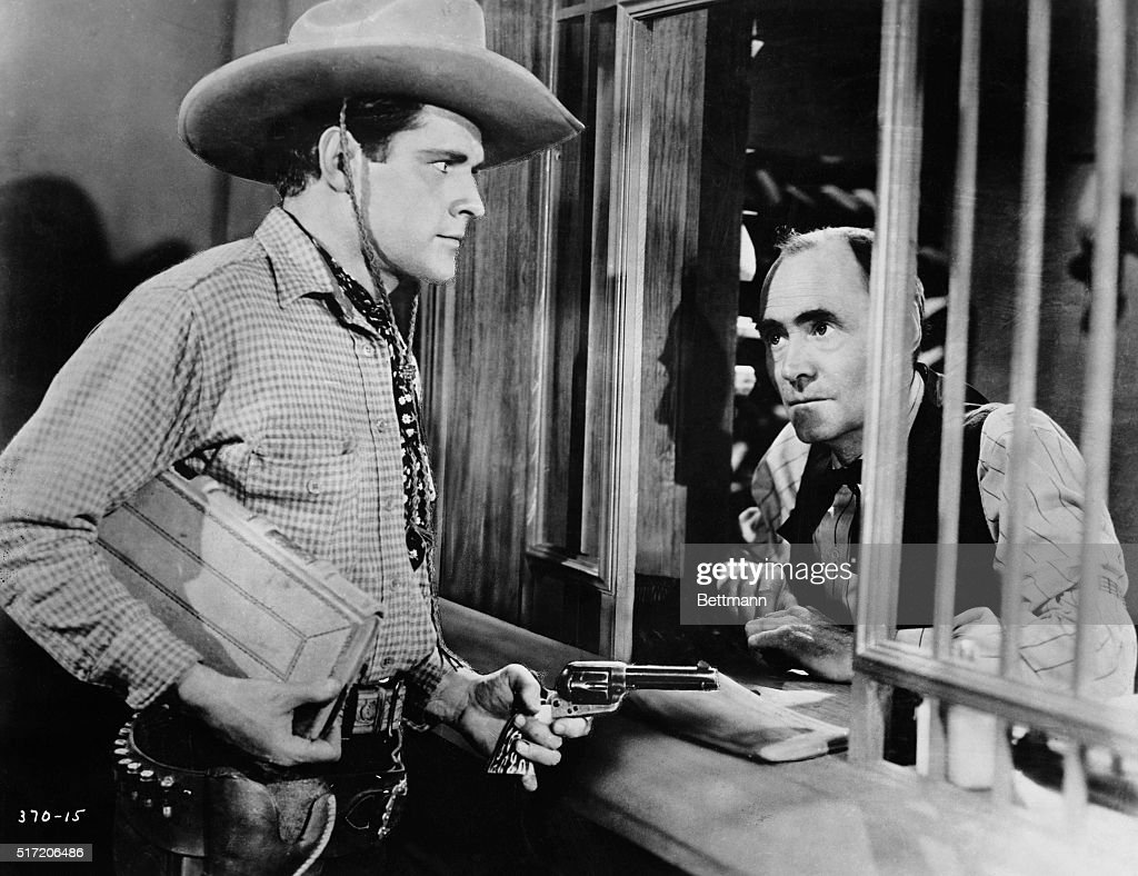 Roy Stewart as a two-handed, masked gunman of the West. Movie still circa 1910s.