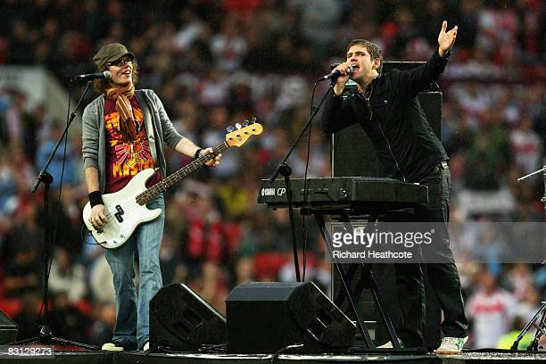 Roy Stride and Greg Churchouse of Scouting for Girls perform prior to kickoff during the engage Super League Grand Final between StHelens and Leeds...