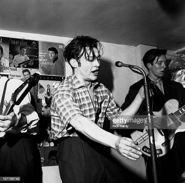 Roy Tempest performs on stage at the 2Is Coffee Bar in Soho circa 1959