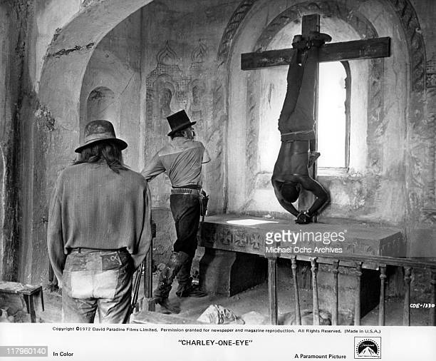 Roy Thinnes watches Nigel Davenport whip Richard Roundtree in a scene from the film 'CharleyOneEye' 1972
