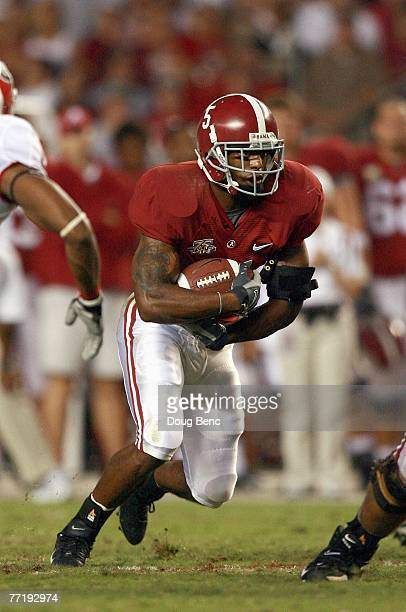 Roy Upchurch of the Alabama Crimson Tide carries the ball against the Georgia Bulldogs at BryantDenny Stadium September 22 2007 in Tuscaloosa Alabama...