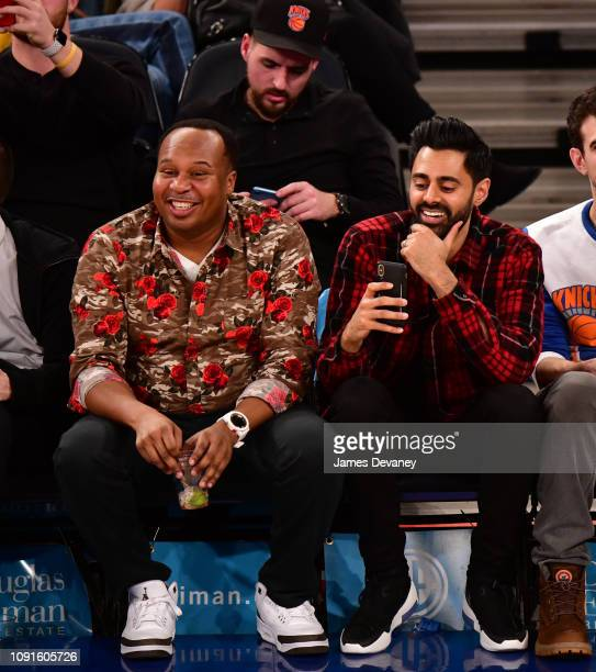 Roy Wood Jr and Hasan Minhaj attend Dallas Mavericks v New York Knicks game at Madison Square Garden on January 30 2019 in New York City
