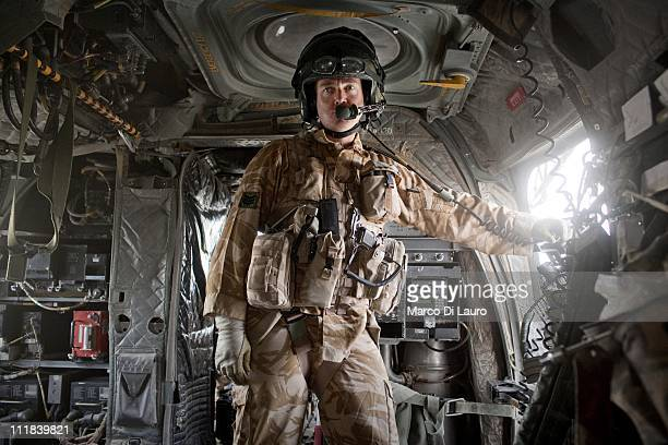 Royal Air Force 18 SQN loadmaster SGT Darrell Harding 40yearsold is seen on board of the MERT CH47 Chinook helicopter as the members of the MERT fly...