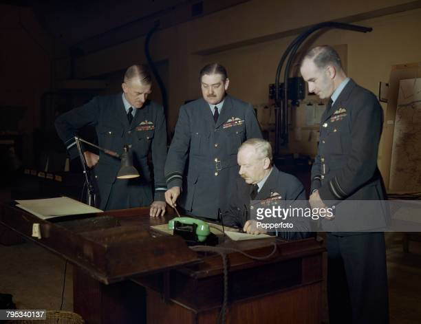 Royal Air Force Air Chief Marshal Arthur Harris pictured seated with his staff from left Air Vice Marshal Robert Dickinson Oxland Air Marshal Robert...