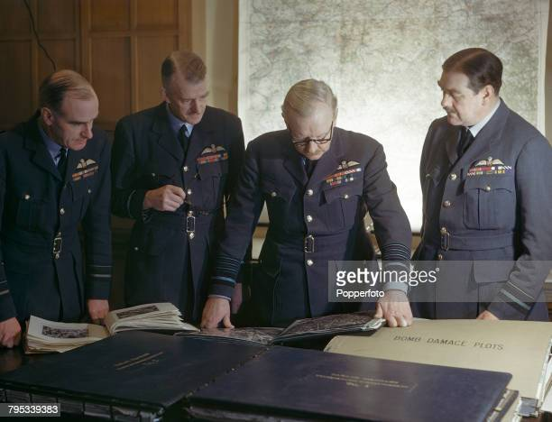 Royal Air Force Air Chief Marshal Arthur Harris pictured standing 3rd from left with his staff from left Air Vice Marshal Hugh Walmsley Air Vice...