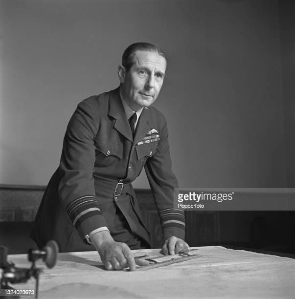 Royal Air Force Air Chief Marshal Sir Philip Joubert de la Ferte , Air Officer Commanding-in-Chief RAF Coastal Command, studies a map at Coastal...