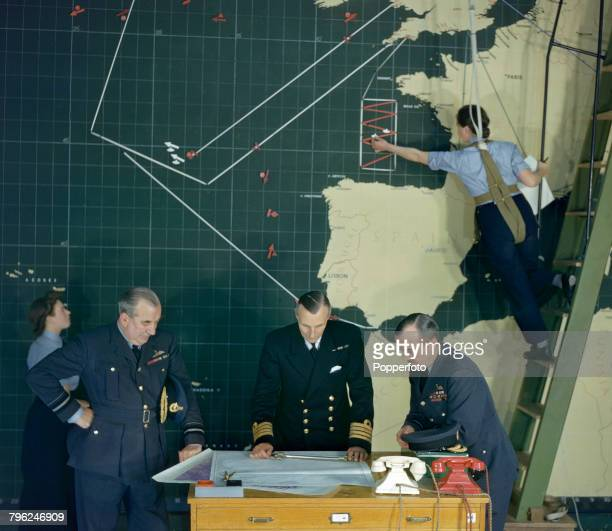 Royal Air Force Air Marshal John Slessor Chief of Coastal Command pictured on right with Naval Liason Officer Captain Dudley Vivian PeytonWard of the...
